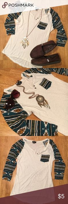 Thin tribal/Aztec baseball tee, tan & turquoise This baseball style t-shirt is a size medium from Rue 21. Quarter length sleeves and it's very thin and light. It's semi see through in the light on the tan part, so you might need a tank underneath. The arms are a tribal/Aztec prince of dark turquoise, gold, brown, and black. Has a pocket on the chest. *All listings ship in 24 hrs* Rue 21 Tops Tees - Long Sleeve