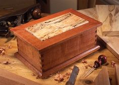 Treasured Wood Jewelry Box Make a big splash with a small piece of rare wood. By Tom Caspar and Jon Stumbras I'll bet somewhere in the dark recesses of your shop you've squirreled away a small piece of special wood, just waiting for the right project. Woodworking Box, Woodworking Magazine, Popular Woodworking, Woodworking Furniture, Woodworking Projects, Youtube Woodworking, Woodworking Classes, Woodworking Videos, Wooden Jewelry Boxes