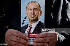 01-20 A supporter of Bulgarian Socialist party holds a picture... #rogaskaslatina: 01-20 A supporter of Bulgarian… #rogaskaslatina