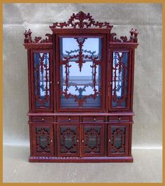 Bespaq Museum Quality Detailed Sideboard Hand made from wood finished in Walnut Delicate carving in wood to the doors Real glass in doors Glass shelves and mirrored back.