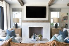 White brick fireplace with reclaimed wood mantel. Painted White brick fireplace with reclaimed wood mantel. Patterson Custom Homes Minimalist Living Room Decor, White Brick Fireplace, Wood Interior Design, Family Room, Family Living Rooms, Tan Living Room, Living Room Designs, Fireplace Surrounds, Luxury Interior Design