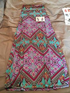 LOVE the colors and patterns on this skirt, this is my favorite one. Would love to get it my next fix!