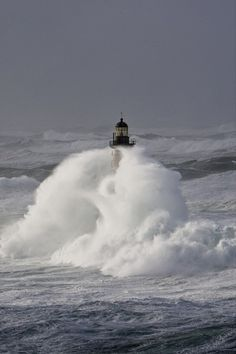 Lighthouse engulfed by waves