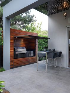 Love the hidden BBQ area! Could be used to store pool toys and towels