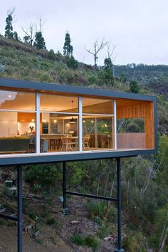 "Container House - Wood house with single level ""built at the height"" on a metal frame - Who Else Wants Simple Step-By-Step Plans To Design And Build A Container Home From Scratch? House On A Hill, House In The Woods, Residential Architecture, Interior Architecture, Contemporary Architecture, Vintage Architecture, Chinese Architecture, Futuristic Architecture, Amazing Architecture"