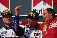 Damon Hill and David Coulthard celebrate on the podium at the 1995 Hungarian GP. They finished 1st and 2nd respectively
