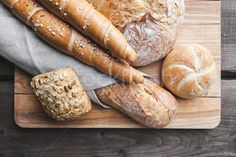 Delicious fresh bread on wooden background stock photo (c) tommyandone (#8453623) | Stockfresh
