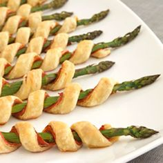 Asparagus spirals ...look easy and yummy! Easy to prepare, but oh so elegant...these tempting appetizers feature asparagus spears individually wrapped with prosciutto, garlic & herb cheese and flaky puff pastry.