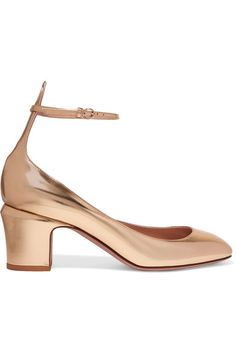Valentino's 'Tango' pumps are a brand signature. The perfect way to elevate everyday outfits, they're made from glossy gold leather and finished with a comfortable block heel and flattering ankle tie. Style yours with this season's cropped flares.