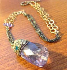Gorgeous Amethyst Pendant with Gemstone accents and a Mixed Metal Chain. $175.00, via Etsy.