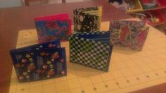 Boys duct tape wallets. Mario Bros., skull and cross bones, Spiderman, checkered print duct tape crafts.