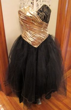 Vintage 80's Formal Gold Lame, Black Tulle and Lace Full-Skirted Prom Dress. $60.00, via Etsy.