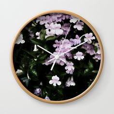 """Trumpet Flowers Noir by BlakCircleGirl Wall clock Good times! Rethink the traditional timepiece as functional wall decor. You'll love how our Artists are converting some of their coolest designs specifically into Wall Clocks. Constructed with premium, shatter-resistant materials, with three frame color options.      - Natural wood, black or white frame options   - Dimensions: 10"""" diameter, 1.75"""" depth  #wallclock #clock #flowers #photography #society6"""