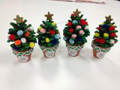 Very fun to make with kids ! Nice and cheerful - painted pinecone, mini pompoms, tiny plant pot - could make into an ornament too