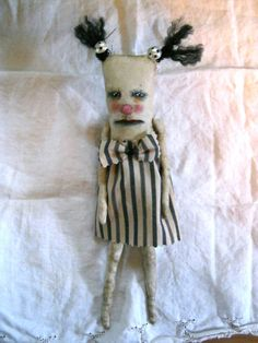 a weird art doll in stripe dress sandy mastroni by sandymastroni