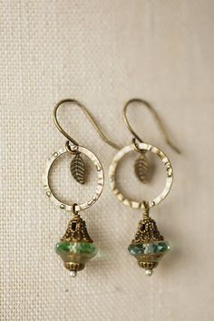 Handmade copper-like earrings instead use antique brass, which will not tarnish, and pairs with Czech glass in these handcrafted dangle earrings