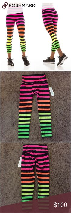 "K DEER Josephine Stripe Neon Capri Yoga Pants M New with tag! K Deer Josephine stripe neon rainbow capri crop leggings. Size medium. Authentic! Color motif: neon pink, orange, yellow and green, deliciously intermixed with black stripes. 20"" inseam can stretch to 22"". Can also be scrunched up for a shorter look. Comfortable higher waistband. Great for yoga, running, dance, paddle boarding & more! UPF 50+ protection. Luxurious, lightweight fit and feel. LOWBALLERS will be blocked. Smoke-free…"