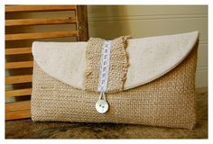 burlap lace clutch purse Personalize Bridesmaid burlap clutch tan purse lace Raffia ruffles wedding rustic shabby purse party gift MakeUp - burlap & lace with Raffia rustic charm - fluffy rag ruffles and lace - luminescent shell button - soft padding adds comfort & stability - Lace may vary from photo however width and style will be similar. - Personalization available in hand embroidery: http://www.etsy.com/listing/150091184 - add wristlet straps $2.50 per bag…
