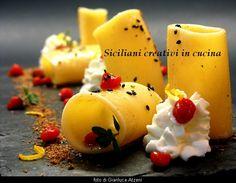 Paccheri con chantilly di mozzarella, emulsione di colatura di alici, sfere di pomodoro e polvere di capperi