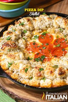Pizza Dip Skillet is a fabulously dippable way to eat your pizza. This easy recipe starts with a scrumptious meat sauce is topped with a layer of ooey gooey cheese and a ring of garlic-Parmesan bread for dipping. It all comes together in one skillet in only 30 minutes!