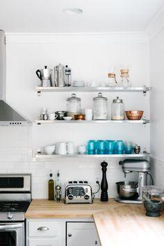 Open upper shelves, butcher block counter