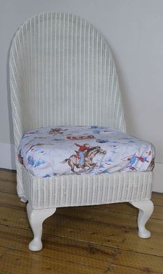Lloyd Loom nursing chair with handmade Cath Kidston cushion   This is the exact chair I have to redo...