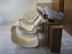 "Other than their spare collection of well-conceived chairs, benches and side-tables, EcoSystems also fabricates made-to-order custom pieces, including the interior furnishings and curvaceous recycled plywood chairs (pictured above) for Soho's Ion Hair Salon, dubbed as New York's first ""eco-salon."""