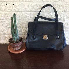 """Vintage black leather handbag Vintage black leather handbag •In excellent condition.  •Bag has a zipped pocket on the back exterior and one on the inside. Opens up to two compartments (shown in last pic) and has tons of space to fill with items.  •Length: 11"""", height: 8.5"""", width: 4-5"""", strap length: 22.5"""". Vintage Bags Shoulder Bags"""