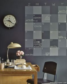 Chalkboard Wall Calendar - A home office is the ideal spot for a family planner. Six weeks' worth of squares in a variety of shades can accommodate several schedules. The entire wall is also coated with chalkboard paint for more memos. Start with a base coat of store-bought black chalkboard paint, then mix in varying amounts of white chalkboard paint for lighter squares.