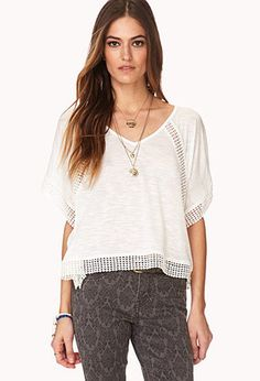 A semi-sheer boxy top featuring crochet trim. V-neckline. Short sleeves. Unlined. Knit.   http://foxyblu.com/products/details/142297