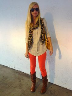 Absolutely LOVE this outfit. Leopard & orange denim with riding boots.