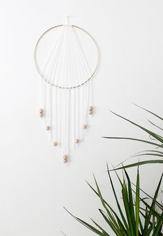 diy modern dreamcatcher using wooden beads