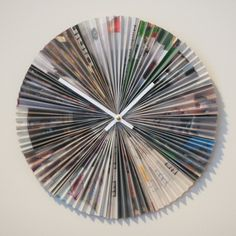 """Love this clock made from magazine pages. There's not a real tutorial, just the creator's brief guideline:  """"No tutorial yet – at some point I may write one up. It's pretty straightforward – accordion-fold 12 sheets of magazine (or paper), then pinch one end of each and glue to a wooden disc (or cardboard circle). Just make sure to leave a hole for the clock shaft!"""""""