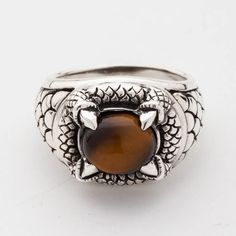A massive tiger eye gem incorporated into a dragon-designed band creates a subtle yet impressive accessory. Gothic Claw Tiger Eyes Mens Ring is made of silver Silver Skull Ring, Mens Silver Rings, Sterling Silver Rings, Skull Rings, Gothic Earrings, Goth Jewelry, Silver Jewelry, Skull Jewelry, Silver Earrings