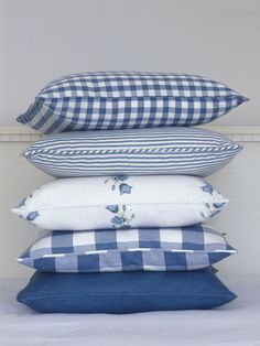 Darling Blue & White Pillows. I hate to play favorites, but that gingham one on top makes me swoon.
