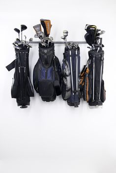 Perfect way to store all the golf clubs in a safe way where they won't get messed up. Perfect father's day gift for the man that is worried about his expensive golf clubs. Love the specialized storage racks from Monkey Bar Storage.