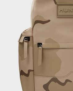 A practical, weatherproof backpack crafted from water-resistant rubberised leather.