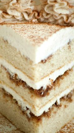 Cinnamon Roll Layer Cake ~ A three layer cake with each layer covered in a cinnamon glaze and completely frosted with a incredible cinnamon frosting.