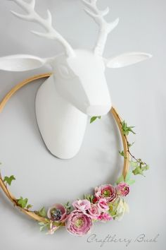 Watercolor Flowers Embroidery Hoop Wreath: this is a completely gorgeous Valentine's Day project that would look great throughout spring, too! Such a creative idea: embroidery hoop + paper flowers = gorgeous.