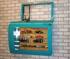 Display cabinet made from 56 Chevy wagon front door.  This is an awesome idea to display my models!