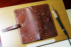 Pyrography on leather wallet.
