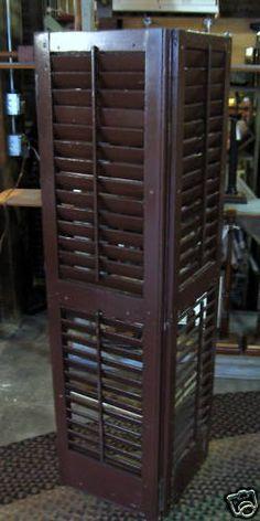 Make corner shelf out of shutters.