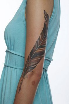 womens tattoos arm feathers and roses | Nice feather on full arm Female tattoo