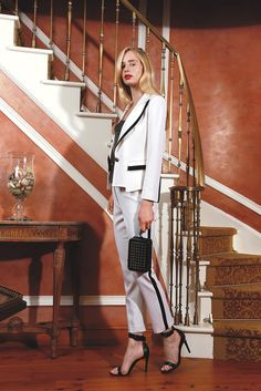 Resort 2014 Trend: Tux Redux (Rachel Zoe's wool suit and Yigal Azrouël's embossed leather corset. Eddie Borgo ring; Diesel Black Gold bag; Tibi shoes.)