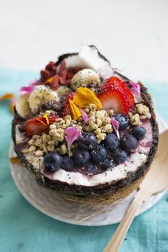 Acai bowls made at home packed with tons of fresh and frozen fruit, chia, goji berries, hemp granola and loaded with vitamins. Served up in a coconut bowl.