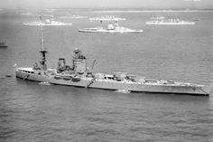 The battleship HMS Nelson off Spithead for the 1937 Fleet Review. Anchored in the background are two Queen Elizabeth Class battleships and two cruisers of the London Class. Picture: Imperial War Museum