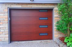 Garage doors have come a long way - and they aren't just for keeping cars secure anymore. Check out this Forbes article for interesting garage door applications. Used Garage Doors, Modern Garage Doors, Overhead Garage Door, Garage Door Design, Garage Door Opener, Santa Monica Houses, Architect Design, Garages, My House