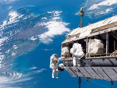 ISS - Out for a walk with a friend - by Chris Hadfield