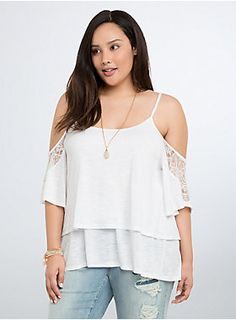 "<p>This loose and lightweight white knit top layers up and boogies down with bohemian-inspired cold shoulder cutouts. The white knit doubles the comfort (check out the layered swing) while the lace trim on the sleeves demands a night out.</p>  <p> </p>  <p><b>Model is 5'10"", size 1</b></p>  <ul> 	<li>Size 1 measures 27 1/4"" from shoulder</li> 	<li>Polyester/rayon/nylon</li> 	<li>Wash cold, dry flat</li> 	<li>Imported plus size top</li> </ul>"