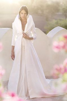 I love the classical cut of this beautiful gown and the high neckline :)